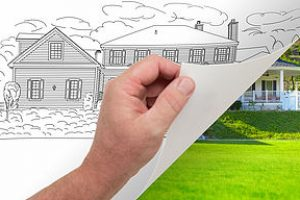 Male Hand Turning Page of Custom Home Photograph to Drawing Underneath.
